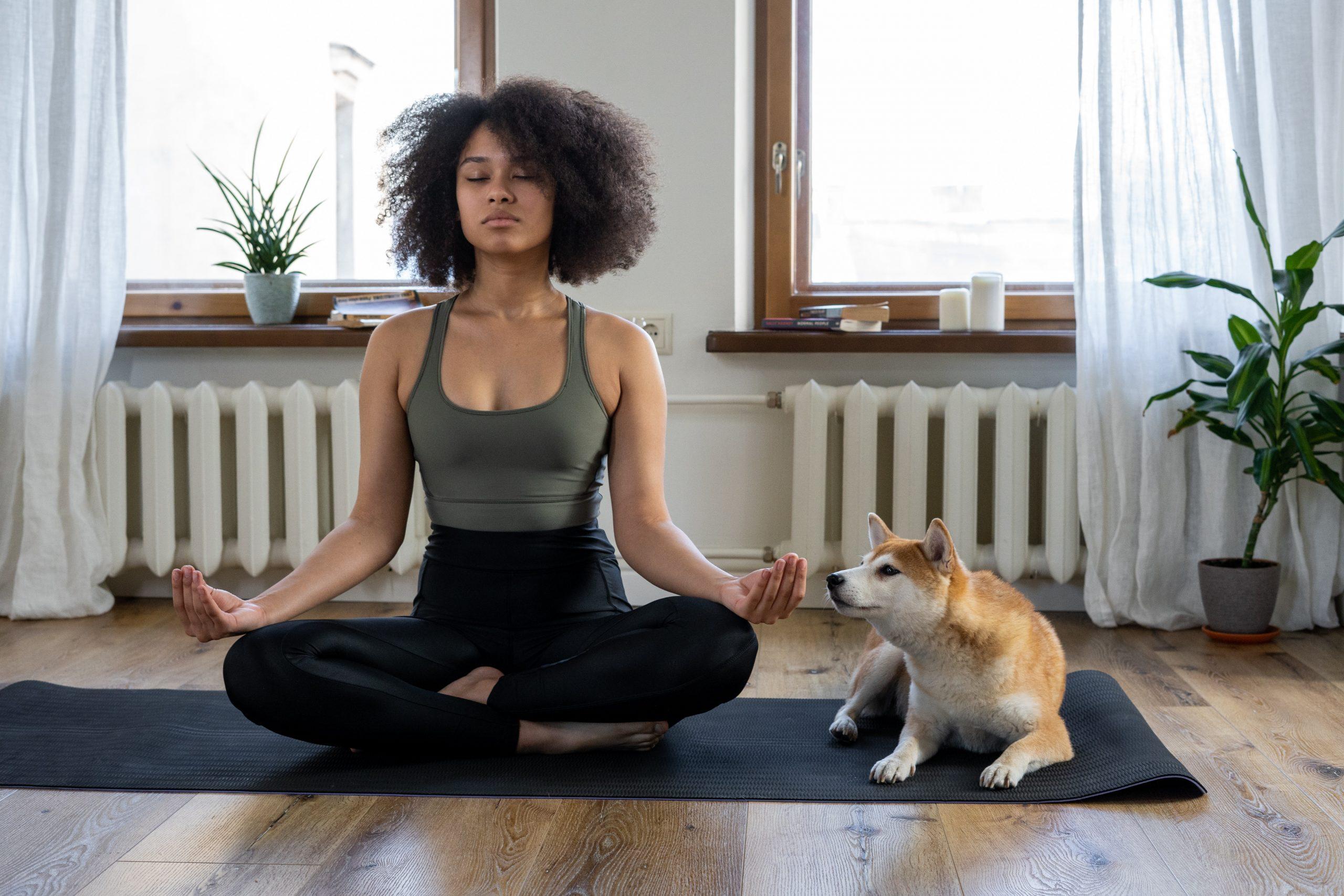 woman meditating with dog